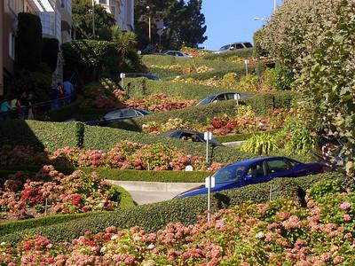 Cars zig-zag down Lombard Street
