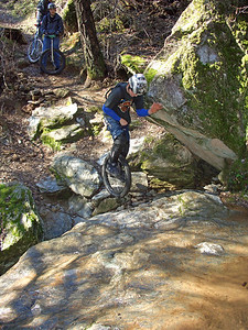 Zack jumping down onto some real slippery rocks