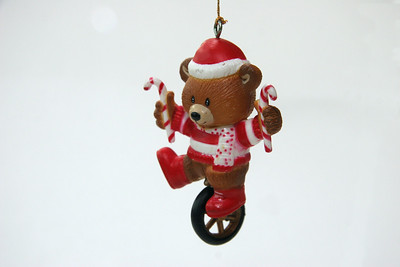 One-footing bear with candy canes