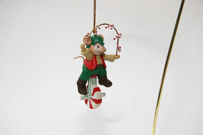 Mouse on peppermint wheel, juggling candy canes