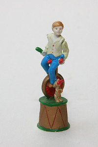 """Pewter juggling boy with dog, about 3"""" high. his arms move"""