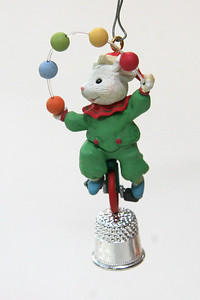 "Yet another unicycling mouse, this one ""fake"" juggling 5 balls on a thimble"