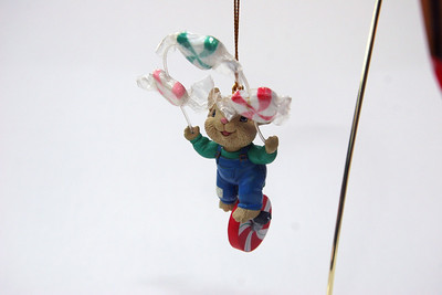 Another mouse on a peppermint wheel, this one juggling wrapped candies