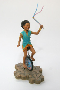Part of a collectible set, this unicyclist can be fit together with other pieces of a children's circus
