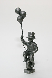 "Pewter statue with balloons, about 9"" high"