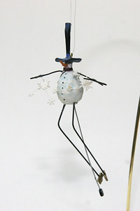 Crazy snowman with tiny-wheeled unicycle. his feet are brushes!