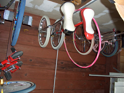 Stuff hanging in my garage: BC wheel and my old and new Freestyle unicycles