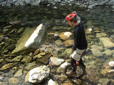 John rides in the river rock