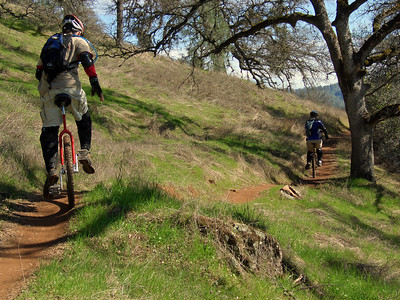 Tim  Bustos follows Robert Allen on the Culvert Trail
