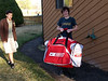 Beau with the one of the other two Nathans. Here he shows off his awesome Canadian hockey (unicycle) bag.
