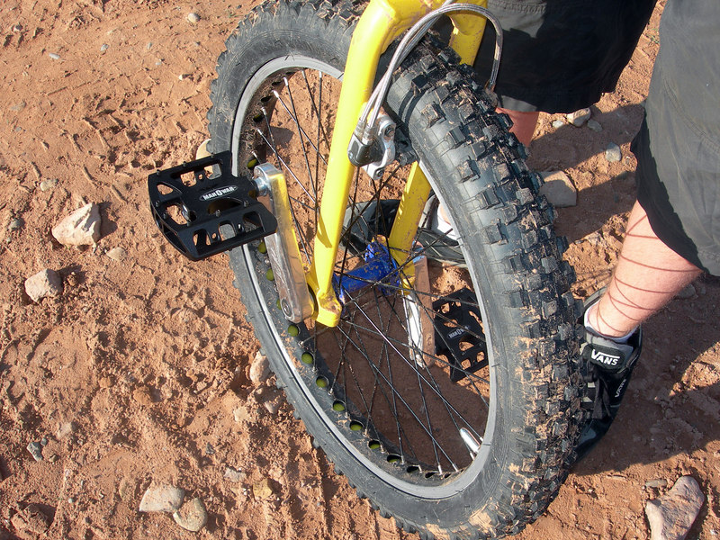 Sunday morning at the Pritchett Arch trailhead. Beau shows off the pedals he won last night, donated by dad.
