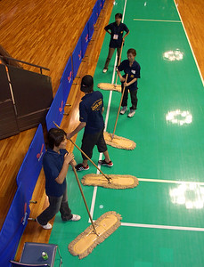 The mop brigade. They were always ready, and kept the dust off the floor in good formation.