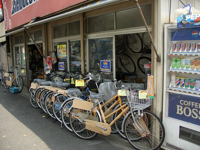 The world's shallowest bike shop. Yes, that's the back wall. It's a very narrow strip of land between the street and the train tracks.