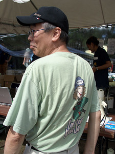 "Hiroshi Masuda, one of the principals of the JUA, enjoys his ""You don't know Jack!"" shirt. He knows Jack all too well."