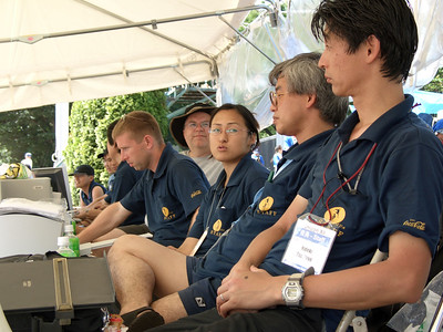 Track officials. In front is Hideki Tsuchiya, who looks an awful lot like his older brother Fuyuki. They were both at Unicon I. Next is Masahiko Hayashi (hope I spelled that right). Then Junko, the translator with the best command of American English. Then Tom Daniels and Andy Cotter.