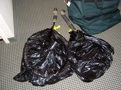 Put the wheels in garbage bags. This keeps things cleaner, and also makes them slide in and out of the bag much more easily! For a more compact packing job, remove the frames from the wheels (put all the hardware bits in ziploc bags. Bring extra ziplocs, and extra garbage bags for the trip home (the originals may get torn up).