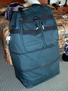My wonderful, wheeled, expandable, soft-sided unicycle luggage, available at your local flea market's luggage vendor for $30 or so. For this trip I had both extensions opened. Those black lines across the bag are the extension zippers, and usually I leave one of them closed, which makes the bag close to the usual maximum allowable size. However, this bag can still be measured as oversized with one extension closed, so be advised. So far I've never had to pay for oversize, probably because it just looks like regular luggage. And that was before the airlines got so strict. Today it would probably be way too expensive to fly with this bag fully extended.