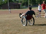 Max Dinemans. Cast on his leg (previous injury), Fireball tires on his wheelchair, and not missing out on the fun!