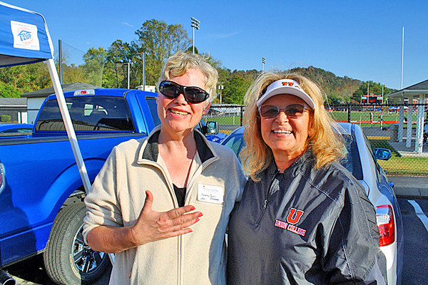 Bev and the college president at the Football Alumni Tailgate.