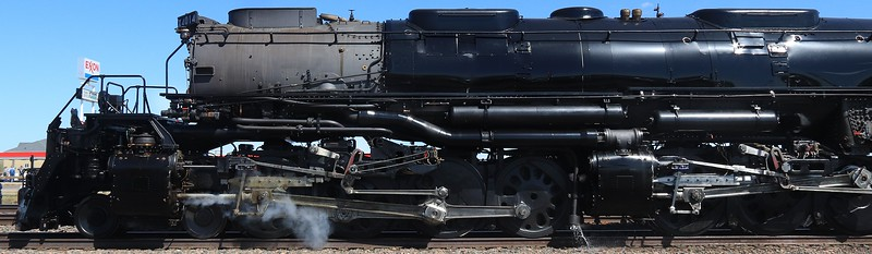 The boiler and smokebox are not directly connected to the front driving wheels, which creates an odd motion of apparent separation in a turn. The front of the boiler will move sideways and point away from the cylinders in a tight turn or rail switch.