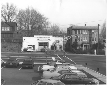 The building on the right was Price's General Store originally located on the North east corner of Morris Ave. and Stuyvesant Ave. The peaked roof was taken off and the building was moved to the foot of Burke Parkway in the 1920's and turned into apartments.