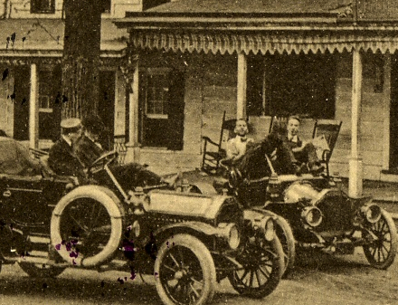 Men in their cars in front of the Meeker Inn.