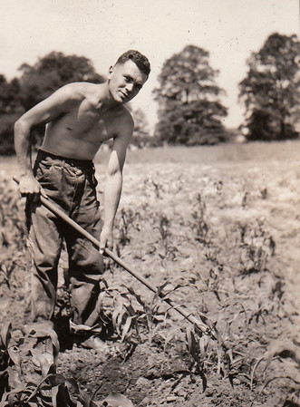 Charles Hopkins Jr. hoes some crops in the fields on West Chestnut.