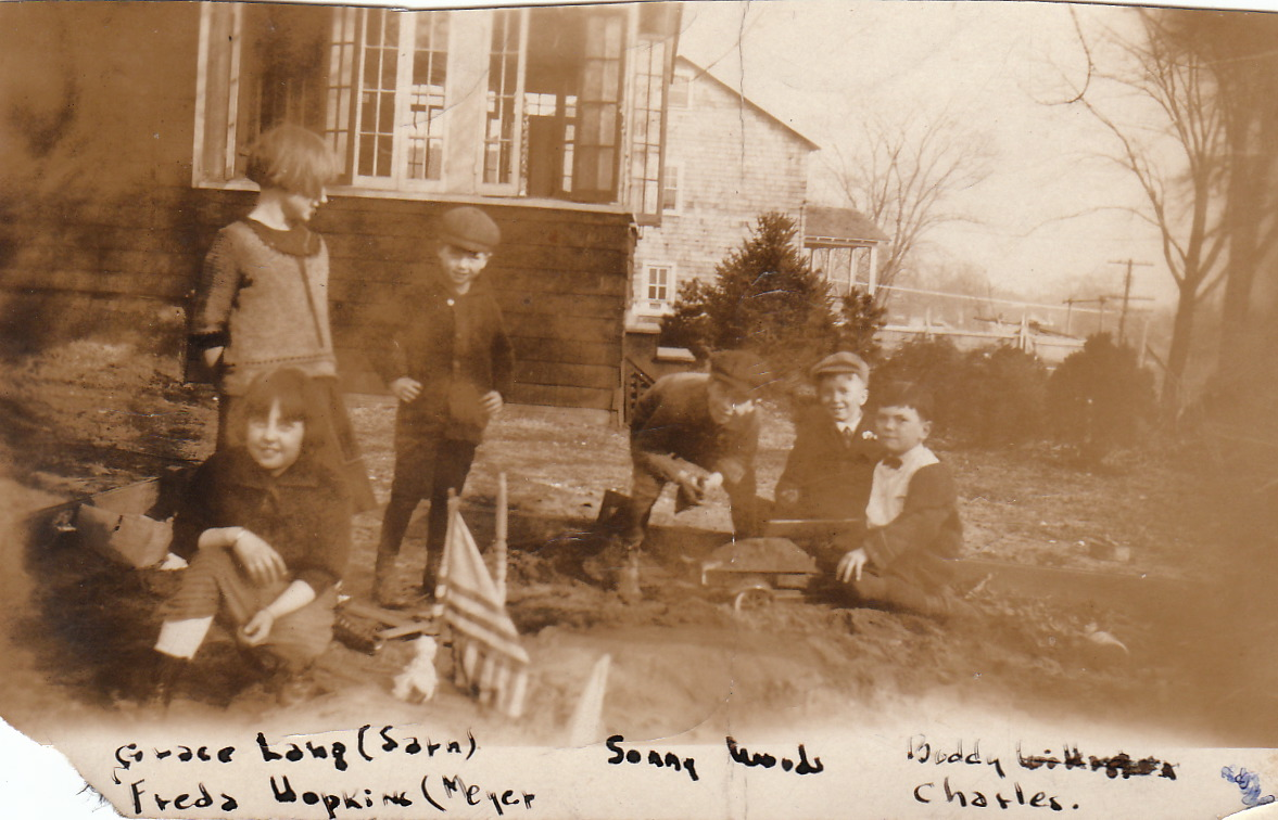 In sandbox under old apple tree, c 1921