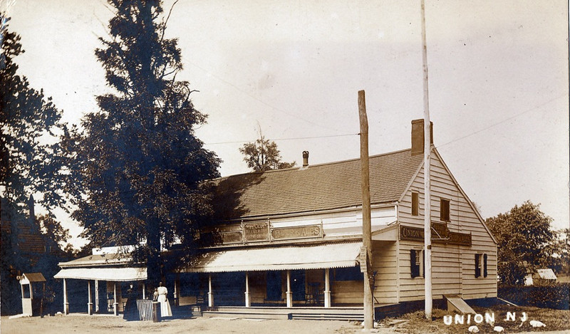 "The Meeker Inn - 1910 with ""Beer & Ale"" Signs"
