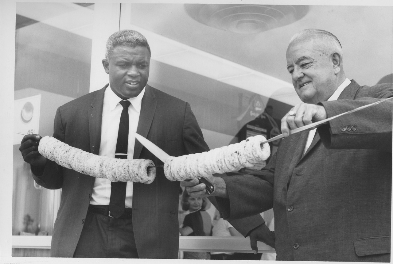 Baseball Hall of Fame's Jackie Robinson helps Mayor Biertuempfel at the grand opening of Chock Full O' Nuts just east of The Flagship on Route 22.