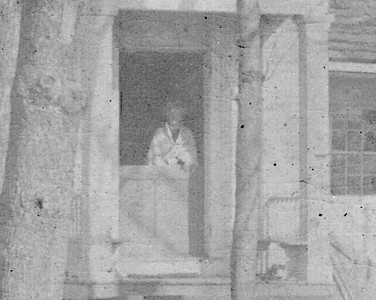 Caldwell Parsonage about 1910 with an unknown woman standing in the doorway. Could it have been the ghost of Hannah Caldwell or perhaps just a woman who lived there.