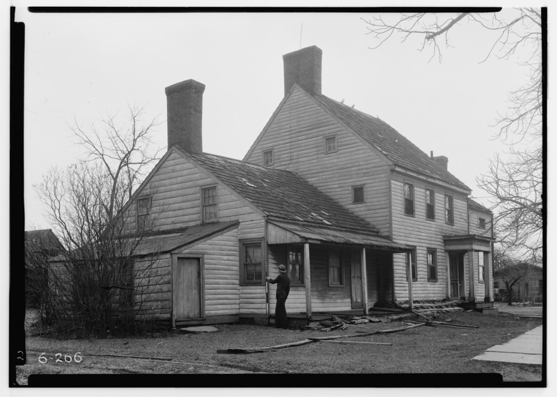 This 1938 photo shows a 1783 house currently located at 1835 Vauxhall Road that is referred to as the Brandt -Headley Farm House in a 1938 study done by the Work Projects Administration (WPA) in order to document historic structures in the area. WPA worker with surveyor's offset rod used to indicate the scale of the house.