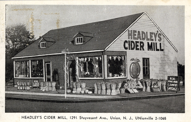 "Headley's Cider Mill was at the current site of The Union Leader building on Stuyvesant Ave at Mountainview Ave. The building can be seen on the 1955 aerial photo.  From the blog of former Unionite Lee Frank who comments on Phillip Roth's writings about Union in ""Portnoy's Compaint"" and his own experiences.         On page 255, he writes, ""When my father drives out to buy 'real apple cider' at the roadside farmer's market off in Union . . ."" You might think he means one of those little open air stands by the side of a bucolic road. Nope. Even in the days of Roth's childhood, most of Union had been developed for some time. (As I recall, it was the site of a Revolutionary war skirmish, back when it was part of neighboring Springfield.)         The street that his father drove into Union from his area of Newark had to be Stuyvesant Avenue, which runs mostly north-south, from South Orange (in the north) to Route 22, two-thirds of the way through Union. I say it was this street because it was the primary path from Irvington to Union; and the main street of the Weequahic area, Chancellor Avenue, went right through Irvington and connected to Stuyvesant Avenue — as did the bus lines.         But Stuyvesant Avenue was also the where Headley's Cider Mill was located, just three blocks up the hill from my parent's home off Stuyvesant on Long Terrace. A walk I made hundreds of times (probably over a thousand), usually past the mill to stores — like the new Grand Union supermarket — further south on Stuyvesant. Or even further, about three-quarters of a mile, to the center of town (intersection of Stuyvesant and Morris Avenues). However, my first walks up that hill were with my father, to that cider mill.         Headley's (if I remember the spelling) was an actual cider mill, with a real wooden cider press. Why was it there if the town, especially along Stuyvesant Avenue, was already developed? Because it abutted one of the last areas in town to be developed, the aptly (pun) named Orchard Park. As in apple orchards. This area, to the east behind the homes and business of Stuyvesant Avenue, also adjoined a few small farms, one of which was still in existence when my family moved into Long Terrace in 1945. In fact, Long Terrace was only a dozen or so houses long as it ran into Orchard Park, which had been developed just a year or two before we moved there. That development extended our street by a few hundred yards.         Headley's was a full-fledged cider mill, a building housing the press (a monstrous mechanical affair to a nine-year old), storage, retail, and an actual bar where one could sidle up (pun) and order a cold drink of cider. Most of the cider was sold in gallon jugs.         On page 256, Roth says, "". . . as my father and I must travel every November out to that hayseed and his wife in Union, New Jersey (the two of them in overalls), for real Thanksgiving apple cider.""         First, Thanksgiving was not our apple cider holiday of choice. It was, more appropriately I think, Halloween. I don't recall any cider consumed at Thanksgiving, probably because we'd had our full share on Halloween. And when I say full share, I'm talking particularly about a couple of few years later when my friends and I were old enough to go by ourselves to the mill on Halloween night and participate in Headley's famous (to us) Halloween ritual. Which was? FREE cider! Not only free, but if you drank ten full ten ounce glasses, you got to take home a FREE gallon of cider! I suppose someone must have succeeded, but I only recollect throwing up outside the mill. In fact, I saw it as a sign of maturity in our early teens when we decided to skip this ritual.         Now, about that hayseed in overalls. True (about the overalls). Maybe Headley was a hayseed, I was too unsophisticated to notice. (Roth is some four years older than I.) However, I can tell you this: the Headley's owned a considerable farm in western Jersey, about forty miles from Union. I know because one of my friends was chums with the son (whom I recall as Junior) and they took me there once. The farm was large enough for hunting (so they told me), and that Junior (if that was his name) also wore the family uniform of overalls. I think that the mill was only open during the months apples were plentiful, i.e., it was probably closed by Christmas and through the spring.         The mill only lasted a few years into my teens, to be replaced by a two story brick building housing the local weekly newspaper. From one press to another.  http://www.leefrank.com/notebooks/journal/jul16_07.html"