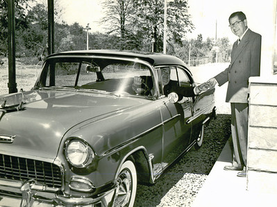 Mayor Ed in his 1955 Two Tone Chevy Belair two door coupe. This was probably taken at the Union Drive-in which was damaged in a hurricane in 1955 and reopened in 1956. http://en.wikipedia.org/wiki/1955_Chevrolet