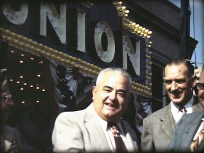 The Mayor in front of the Union Movie Theater at a parade to celebrate Union's 140th birthday.