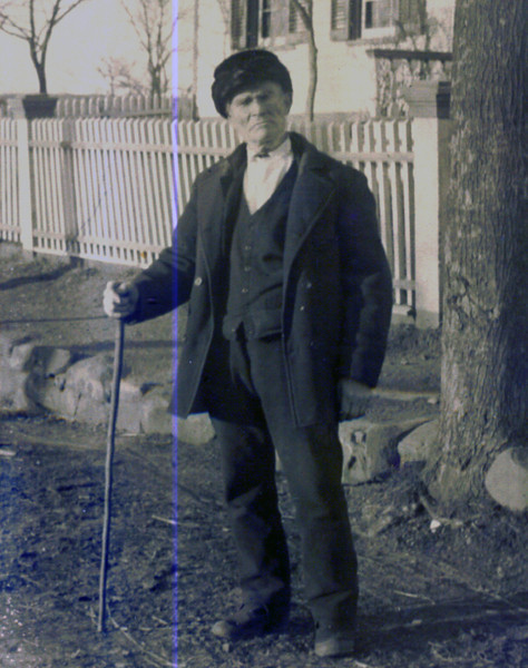Abner Headley (1858 - 1950) in front of the Caldwell Parsonage. Mr. Headley was the last owner of the Caldwell Parsonage before it was sold to the Union Township Historical Society in 1957.