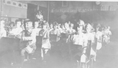 Second Grade class of Dr. Leonard Moore in 1929. Teacher Mrs. Cernacaro is in the background inside the addition of the Connecticut Farms School.