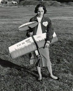Girl holding a model airplane. We think her name is Ginni.