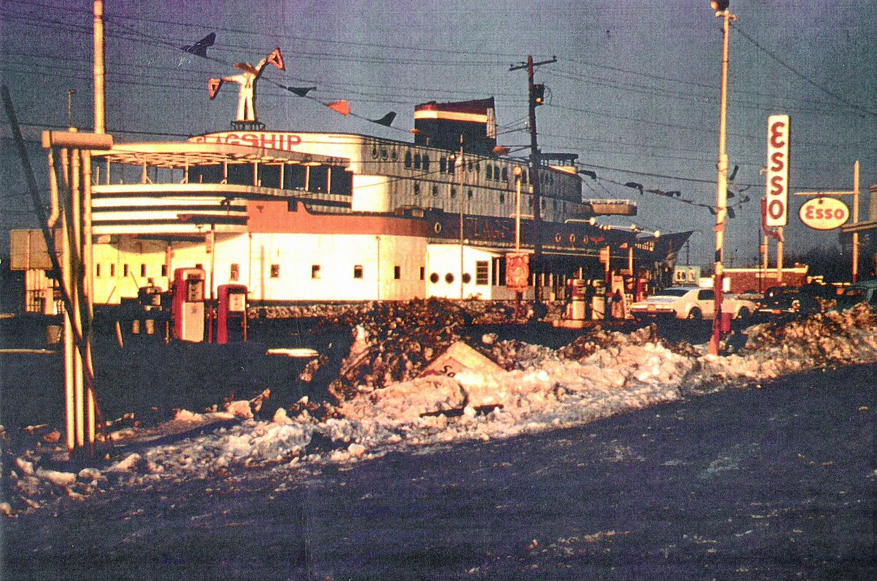 When the Flagship had a gas station at the port bow in the early 70's. What appears to be white caps with floating garbage in the foreground add to the illusion...