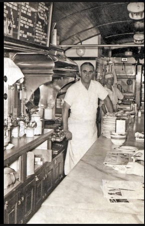 Home Diner owner Gustav Marnett stands proudly behind the counter.
