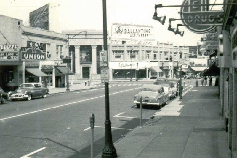"""1953 photo of Union Center. The Union Theater marquis displays the film """"Shane"""" which was an historic milestone in cinema history. Shane was the first film to be shown in the new 1.65:1 widescreen aspect ratio. The movie was not filmed in widescreen but rather in 4 x 3 format. The bottom and top were """"cropped"""" by the projector similar to what some of us do on our 16 x 9 TVs today.    http://www.hollywood-elsewhere.com/2013/03/shane-aspect-ratio-conflict/  http://www.3dfilmarchive.com/home/widescreen-documentation  first film shown in widescreen debuted in radio city on 4/23/53."""