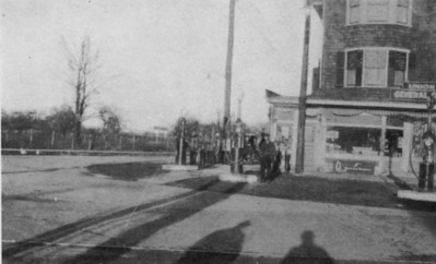 About 1919 this photo shows Harry Smith next to the gas pump in front of Price's Store and Post Office on Morris ave.  looking north onto Stuyvesant Ave.