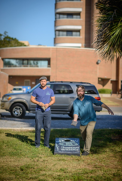 Union Public House co-owners Chef Blake Rushing and Patrick Bolster play Cornhole outside their restaraunt