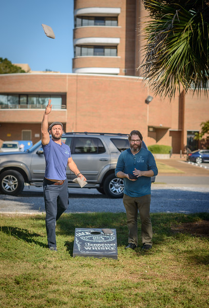 Chef Blake Rushing and Patrick Bolster play Cornhole outside Union Public House