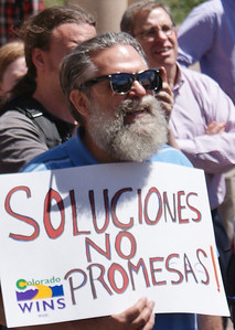 Custodians at the Auraria Higher Education Center in Denver, and supporters, demonstrate over wage cuts, workplace harassment & intimidation, and safety issues. The rally and march was organized by the state employee union Colorado WINS, Jobs With justice and the Student Labor Action Project.  (4/29/13)