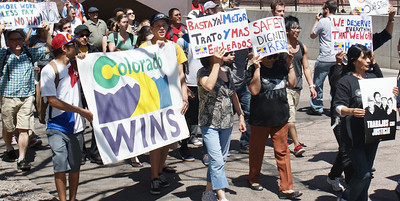 Custodians at the Auraria Higher Education Center in Denver,and supporters, demonstrate over wage cuts, workplace harassment & intimidation, and safety issues. The rally and march was organized by the state employee union Colorado WINS, Jobs With justice and the Student Labor Action Project.  (4/29/13)