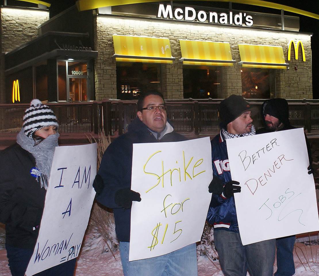 Fast food workers braved single digit temperatures, to demonstrate for higher wages, as well as equal pay for women workers, outside a Denver area McDonalds.