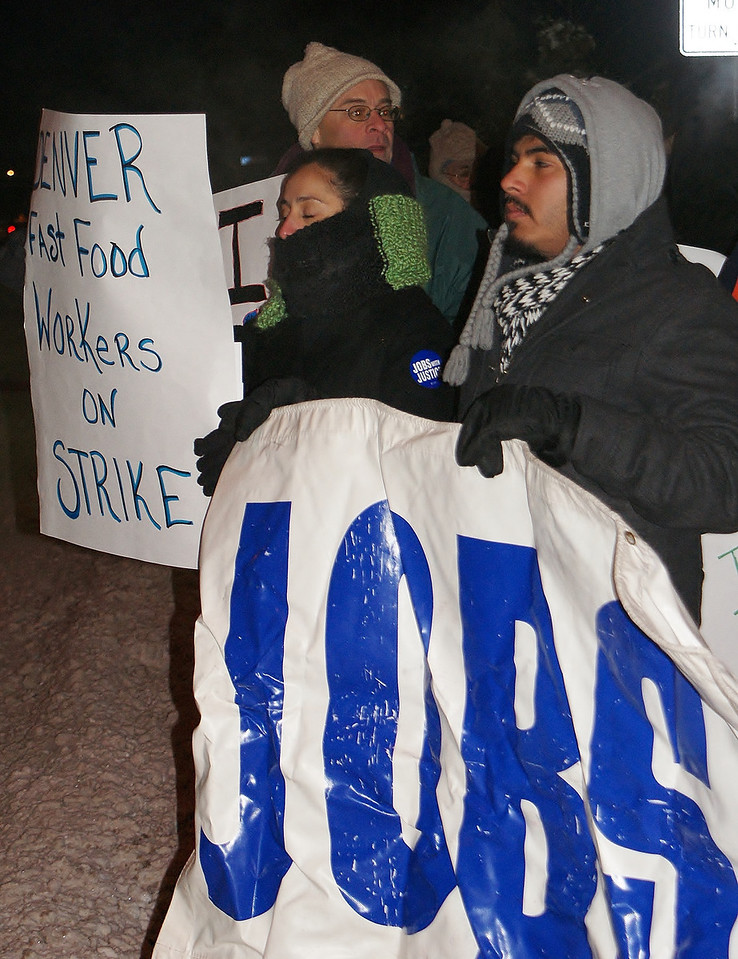 Jobs With Justice members demonstrate for higher wages for fast food workers, in front of a McDonalds in Lakewood, Co
