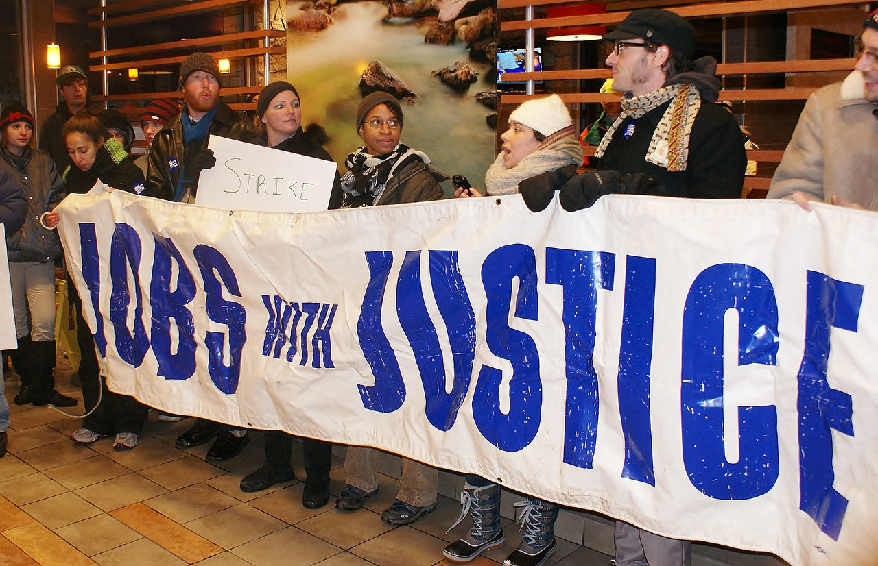 Jobs With Justice members took a protest for higher wages for fast food workers inside of a McDonalds restaurant in suburban Denver, Co.