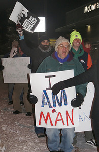 Marchers braved bitter cold to demonstrate for higher wages for fast food workers, outside a Denver area McDonalds.